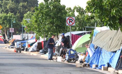 Tents line both sides of Olomehani Street in Kakaako near the Ohe Street intersection. 30dec2014 photograph Cory Lum/Civil Beat